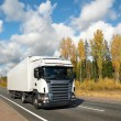 Stock Photo: White truck on autumn country highway