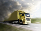 Truck speeding on highway to the light — Stock Photo
