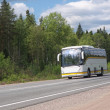 White tourist bus on country highway — Stock Photo #3721089