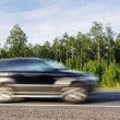 Offroad car speeding on country highway, motion blur — Stock Photo