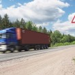 Blue truck speeding on country highway, motional blur — Stock Photo