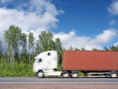 White truck speeding on rural highway, motion blur — Stock Photo