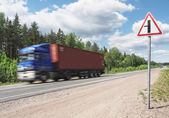 Blue truck speeding on country highway, motional blur — Стоковое фото