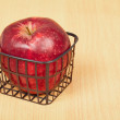Red apple in a small basket — Stock Photo