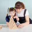 Child and teacher played with lotto — Stock Photo