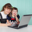 Mom and daughter playing with laptop — Stock Photo