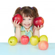 Funny child playing with two red apples — Stock Photo