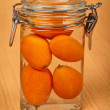 Royalty-Free Stock Photo: Kumquat in small tin can on wooden