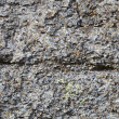 Gray rough surface of natural stone — Stock Photo