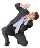Frightened businessman sitting on white backgrou — Stock Photo