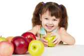 Happy child with apples - sources of vitamins — Stock Photo