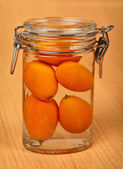 Kumquat in small tin can on wooden — Stock Photo