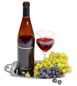 Still life - bottle of wine, glass and grapes on — Stock Photo