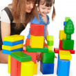 Mother and daughter playing with toys — Stock Photo