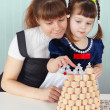 Mother and daughter play sitting — Stock Photo #2764241