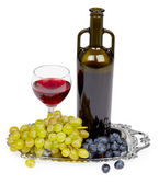 Bottle of red wine, glass and grapes - still lif — Stock Photo