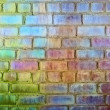 Stock Photo: Rough brick wall iridescent colors