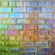 Rough brick wall iridescent colors - Stock Photo