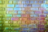 Rough brick wall iridescent colors — Stock Photo