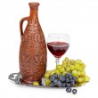 Still life - clay jug and glass of red wine — Stock Photo