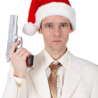 Young man in Christmas hat with gun — Stock Photo
