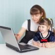 Education of child work with computer — Stock Photo