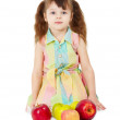 Little girl with apples sits isolated — Stock Photo