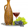 Still life-clay jug,glass of wine,grapes — Stock Photo