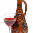Ancient Georgian bottle and glass of wine on whi — Stock Photo