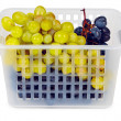 Basket with grapes on white background — Stock Photo