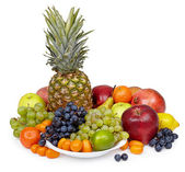 Still life of tropical fruits on white — Stock Photo