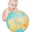 Baby playing with globe of earth — Stock Photo