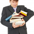 Man - student hold heap of books and textbooks — Stock Photo #2946826