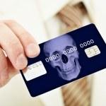 Banking plastic credit card bearing death — Stock Photo