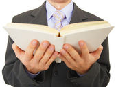 Man reads big book, isolated on white — Stock Photo