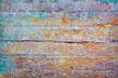 Wall - rotten boards with colored stains — Stock Photo