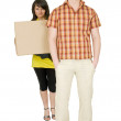 Woman and man bear the big cardboard box — Stock Photo