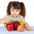 Stock Photo: Girl playing with big ripe apples