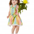 Stock Photo: Happy little girl with a bouquet of flowers