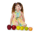 Little girl and train of apples — Stock Photo