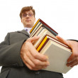 Young man with pile of books in hands — Stock Photo #3007531