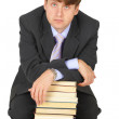 Young erudition man with stack of books — Stock Photo