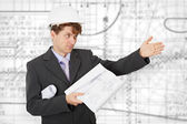 Engineer in a helmet pointing direction — Stock Photo