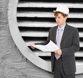Engineer - designer in helmet with drawings — Stock Photo