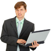 Man with laptop in hand on white background — Stock Photo