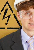 Safety engineer on background of warning signs — Stock Photo