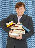 Funny guy with an armful of textbooks — Stock Photo