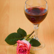 Royalty-Free Stock Photo: Glass of red wine and rose