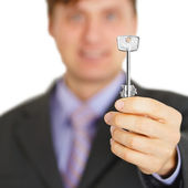 Official gives us key to new house — Stock Photo
