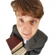 Stock Photo: Funny guy with pile of books